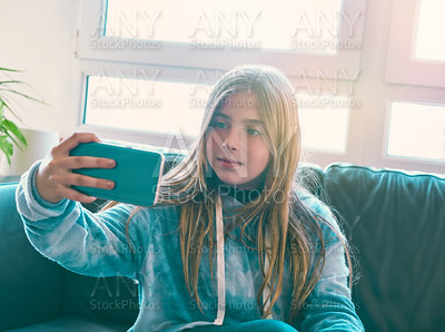 Blond kid girl selfie with a window background