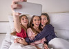 Pajama party best friend girls selfie at bed