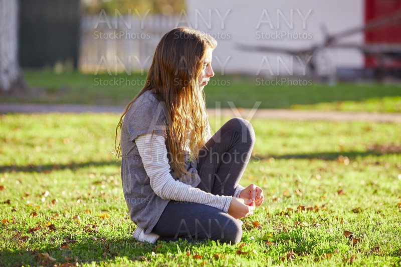 Tween kid girl profile in the park at sunset