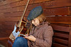 blond kid girl playing guitar with winter beret