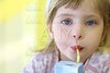 blond little girl drinking straw tetra brick