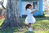 Kid toddler girl with tablet pc playing outdoor