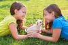 twin sister kid girls and puppy dog lying in lawn