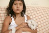 Asian girl with persian white cat on her arms