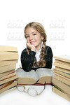 little student blond braided girl smiling with lots of stacked books
