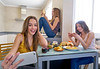 teen girls best friends lunch eating at kitchen