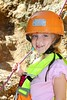 climbing little girl smiling portrait helmet rope