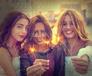 Best friends teen girls with sparklers