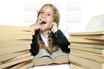 little thinking student blond braided girl with glasses smiling stacked books