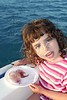Girl with two jellyfish in white dish boat blue sea