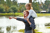 Mother holding daughter in shoulders in a lake
