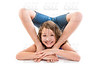 Flexible contortionist kid girl playing on white