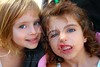 funny two little sister girls funny face gesture