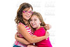 kid girls tender hug smiling ans friends cousins