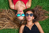 Teenager best friends girls lying down on turf