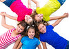 happy kid girls group smiling aerial view lying circle