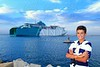 boy teenager in ferry harbor blue sea