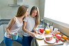best friends girls teens breakfast in kitchen