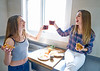 best friend girls eating pizza in the kitchen