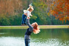 Mother playing throwing up baby girl in a lake