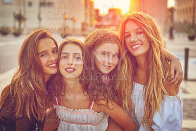 Best friends teen girls at sunset in the city