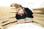 little blond bored student girl thinking relaxed on book