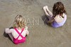 tow sisters sit on beach bathing suit swimsuit