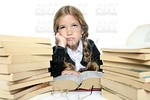 little unhappy sad student blond braided girl bored with stacked books