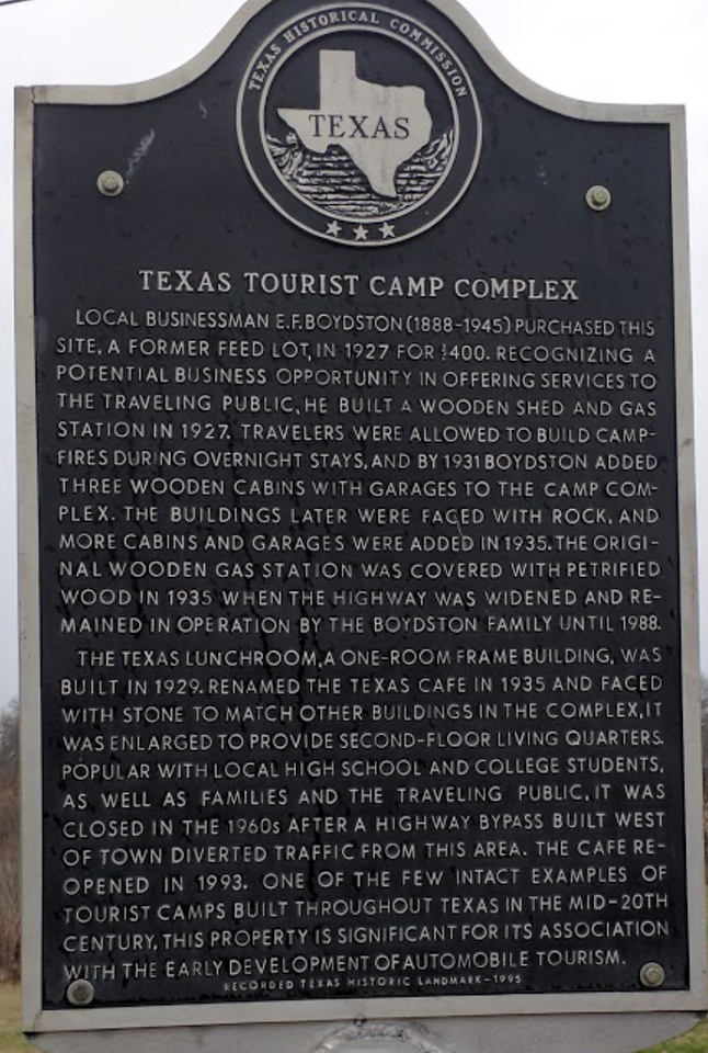 The historical Marker in the parking lot outside the café.