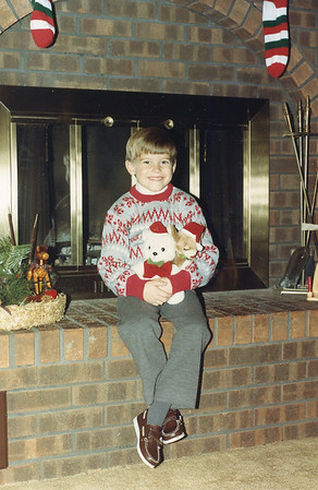 Kyle with stuffed animals December 1987