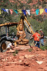 SD-334-99 Setting Buddha down at new location at Amitabha Stupa - by Wib Middleton