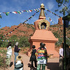 Wib gives a spontaneous tour to a group of visitors to the Amitabha Stupa, in Sedona, Arizona.