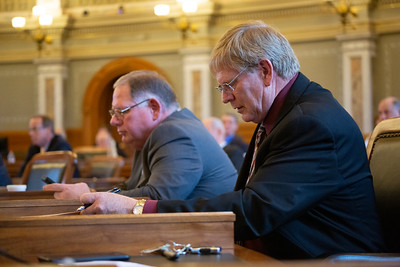 Rep. Leo Delperdang (foreground) next to Rep. Dan Hawkins
