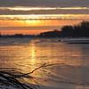 Sunrise on an icy Kansas River