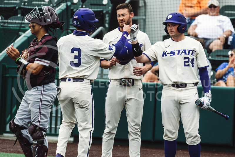The Wildcat's batters celebrate after scoring against the Tigers. K-State scored nine runs on five hits in the fourth inning, bringing 12 to the plate. The Wildcats pulled a 16-1 win over the Tigers at Tointon Family Stadium, Manhattan KS. 5/2/21. (Dylan Connell | Collegian Media Group)