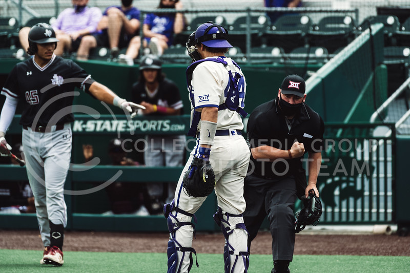 K-State's catcher, Dylan Caplinger, reaches for a runner at home plate to get him out. The Wildcats pulled a 16-1 win over the Tigers at Tointon Family Stadium, Manhattan KS. 5/2/21. (Dylan Connell | Collegian Media Group)