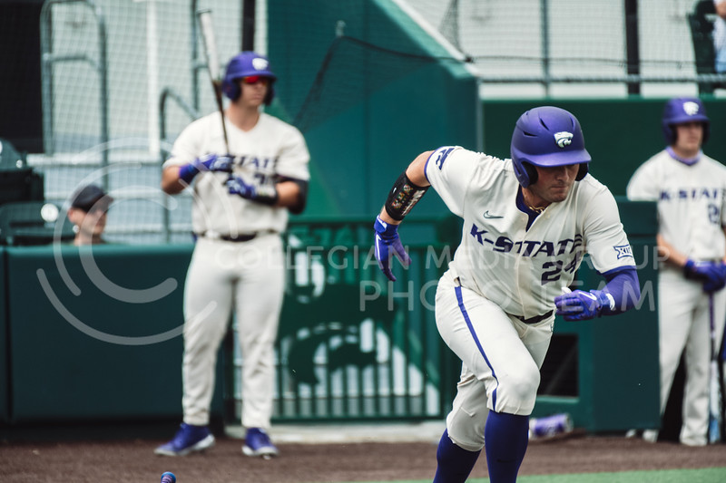 K-State's hitter, Dylan Phillips, runs towards first base after a base hit. The Wildcats pulled a 16-1 win over the Tigers at Tointon Family Stadium, Manhattan KS. 5/2/21. (Dylan Connell | Collegian Media Group)