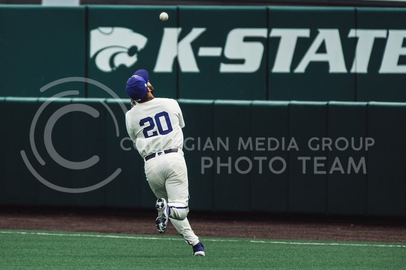 Wildcat's outfielder, Daniel Carinci, catches a pop fly, keeping the Tigers from scoring. The Wildcats pulled a 16-1 win over the Tigers at Tointon Family Stadium, Manhattan KS. 5/2/21. (Dylan Connell | Collegian Media Group)