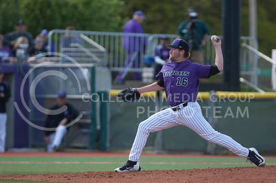 Members of the Kansas State University Wildcats baseball team play against the West Virginia Mountaineers at the Tointon Family Stadium in Manhattan, Kansas on April 22, 2017. The Wildcats went on to win the game with a final score of 8-4. (Justin Wright | The Collegian)