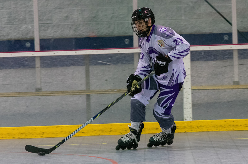 Cameron Kaustinen, a sophomore defenseman, bolts down the rink towards the opposing teams net. The K-State inline hockey team won all four games of the conference tournament on Feb. 23 at Queeny Park Hockey Arena in Ballwin, Missouri. (Brooke Barrett | Collegian Media Group)