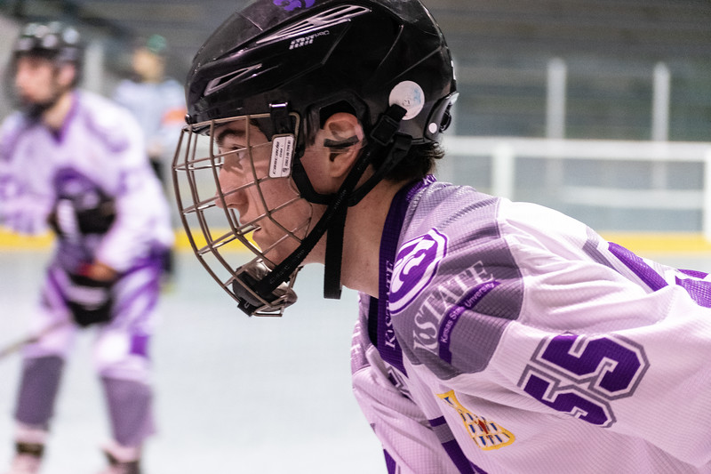 Sean Reading, a junior defenseman, scans the rink searching for a teammate to send the puck to. The K-State inline hockey team defeated Denver 7-3 and captured the conference title on Feb. 23 at Queeny Park Hockey Arena in Ballwin, Missouri. (Brooke Barrett | Collegian Media Group)