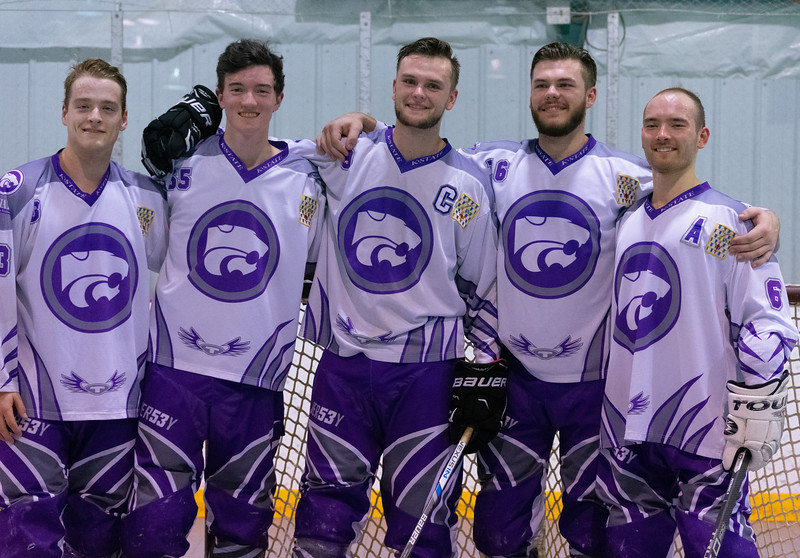 Tyler Brunton (senior), Sean Reading (junior), Jake Schulte (senior), Sam Schulte (junior), and Brendan Crawford (senior) celebrate after finishing their regular hockey season with a tournament win. The K-State inline hockey team won all four games to claim the conference title on Feb. 23 at Queeny Park Hockey Arena in Ballwin, Missouri. (Brooke Barrett | Collegian Media Group)