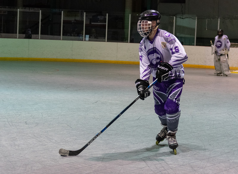 Sam Schulte, a junior defenseman, skates down the rink while browsing for a teammate to pass the puck to. The K-State inline hockey team won all four games of the conference tournament on Feb. 23 at Queeny Park Hockey Arena in Ballwin, Missouri. (Brooke Barrett | Collegian Media Group)