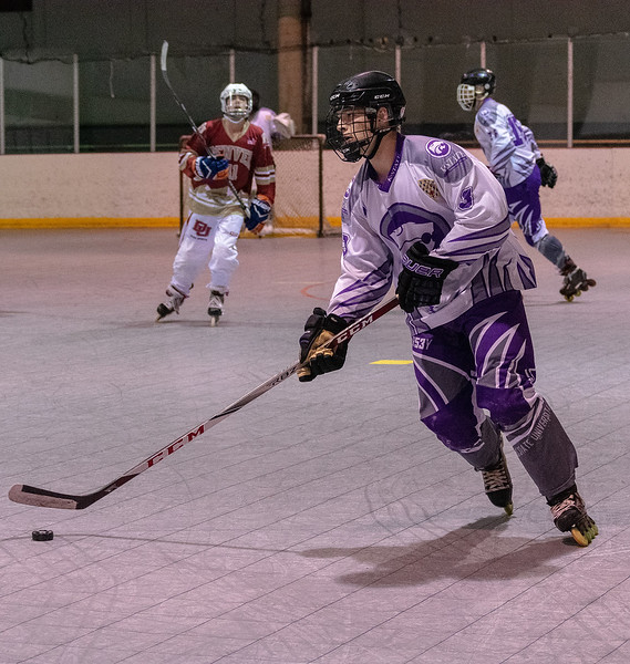 Tyler Brunton, a senior forward, races to the opposing team's goal while browsing for a teammate to pass the puck to. The K-State inline hockey team defeated Denver 7-3 capturing the conference title on Feb. 23 at Queeny Park Hockey Arena in Ballwin, Missouri. (Brooke Barrett | Collegian Media Group)