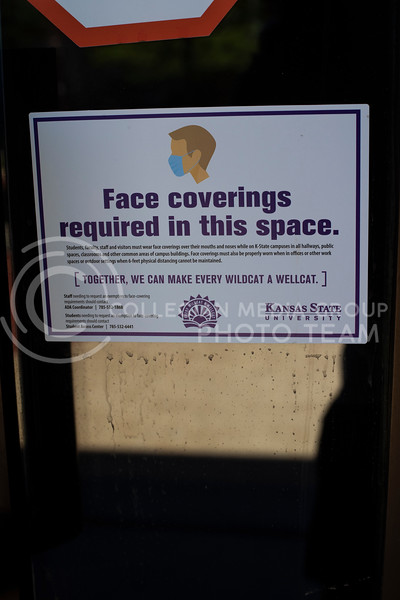 Face covering signs are present on all entrances and exits on campus. With the first day of school beginning during a pandemic on August 17th 2020, precautions have been taken in every aspect of campus in order to keep students and staff safe. (Dalton Wainscott I Collegian Media Group)