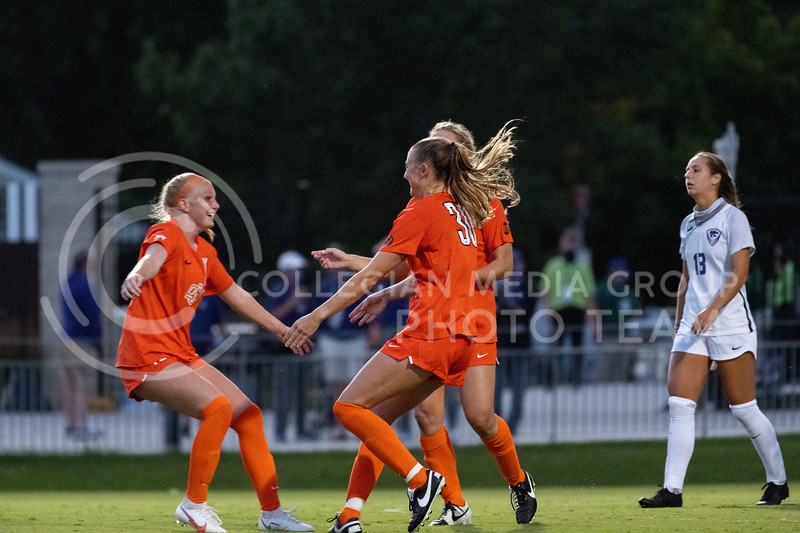 Oklahoma State University woman's soccer team, celebrates after a goal against Kansas State University. The Wildcats fell to Oklahoma State 0-3 at Buser Family Park on September 13, 2020. (Dylan Connell | Collegian Media Group)