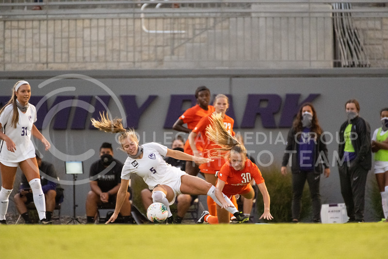 Kansas State University midfielder, Caylee Thornhill, tackles Oklahoma State midfielder, Olyvia Dowell. The Wildcats fell to Oklahoma State 0-3 at Buser Family Park on September 13, 2020. (Dylan Connell | Collegian Media Group)