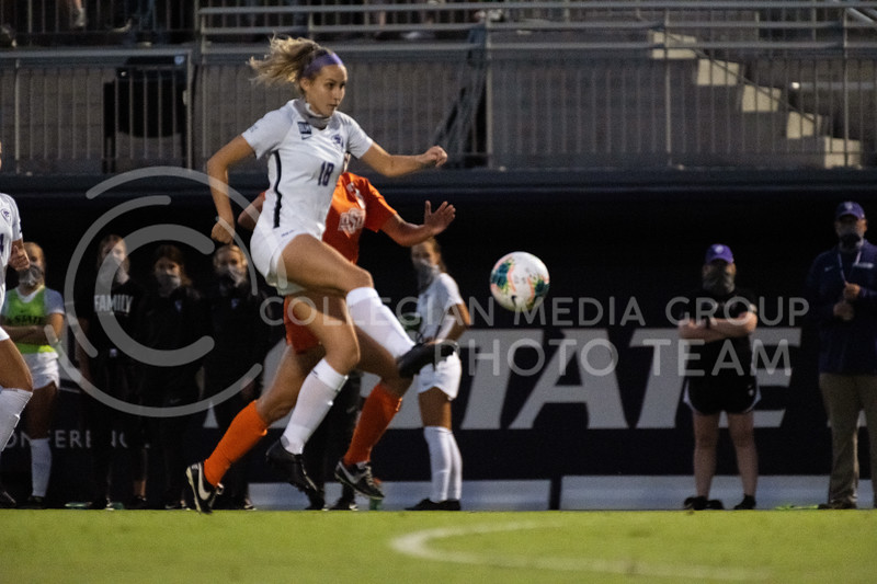 Kansas State University defender, Emily Crain, attacks up the field while being contested. The Wildcats fell to Oklahoma State 0-3 at Buser Family Park on September 13, 2020. (Dylan Connell | Collegian Media Group)