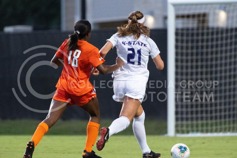 Kansas State University defender, Shelby Lierz, charges with Oklahoma State defender, Charmé Morgan. The Wildcats fell to Oklahoma State 0-3 at Buser Family Park on September 13, 2020. (Dylan Connell | Collegian Media Group)