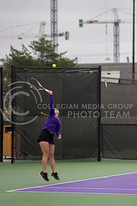 Senior player Livia Cirnu serves the ball at the Mike Goss tennis stadiums on 3.17.30. (Kelly Pham | The Collegian)